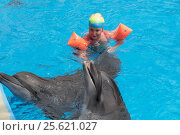 Купить «Little girl swim with dolphins», фото № 25621027, снято 2 августа 2016 г. (c) Михаил Коханчиков / Фотобанк Лори