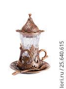 Традиционный восточный стакан для чая в металлическом подстаканнике с арабским орнаментом, фото № 25640615, снято 21 февраля 2016 г. (c) Евгений Ткачёв / Фотобанк Лори
