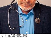 Купить «Senior bearded doctor in suit with stethoscope», фото № 25652303, снято 3 ноября 2016 г. (c) Pavel Biryukov / Фотобанк Лори