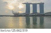 Купить «Sunrise rotating Timelapse - Singapore Marina Bay», видеоролик № 25662519, снято 23 марта 2019 г. (c) Кирилл Трифонов / Фотобанк Лори