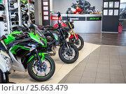 Купить «Мотосалон по продаже мотоциклов и мототехники», фото № 25663479, снято 22 февраля 2017 г. (c) Кекяляйнен Андрей / Фотобанк Лори