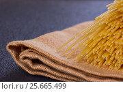 Uncooked pasta on a cloth. Стоковое фото, фотограф Дегтярева Виктория / Фотобанк Лори