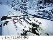 Купить «Car driving with skis on roof rails in the evening», фото № 25667463, снято 20 декабря 2016 г. (c) Сергей Новиков / Фотобанк Лори