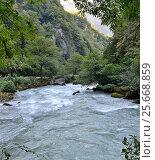 Купить «View of the mountain river Yupshera Abkhazia», фото № 25668859, снято 26 сентября 2014 г. (c) Александр Карпенко / Фотобанк Лори