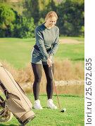 woman preparing to hit ball at golf course. Стоковое фото, фотограф Яков Филимонов / Фотобанк Лори