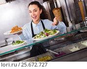Купить «Adult brunette girl with kebab and vegetables», фото № 25672727, снято 19 сентября 2018 г. (c) Яков Филимонов / Фотобанк Лори
