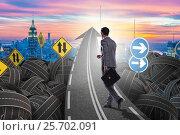 Купить «Businessman in uncertainty concept on road intersection crossroa», фото № 25702091, снято 31 марта 2020 г. (c) Elnur / Фотобанк Лори