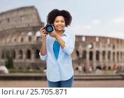 Купить «happy afro american woman with digital camera», фото № 25705871, снято 17 декабря 2016 г. (c) Syda Productions / Фотобанк Лори