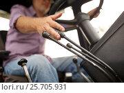 senior man driving tractor at farm. Стоковое фото, фотограф Syda Productions / Фотобанк Лори
