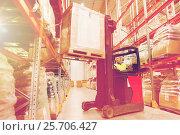 Купить «man on forklift loading cargo at warehouse», фото № 25706427, снято 9 декабря 2015 г. (c) Syda Productions / Фотобанк Лори