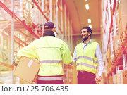 Купить «men in safety vests shaking hands at warehouse», фото № 25706435, снято 9 декабря 2015 г. (c) Syda Productions / Фотобанк Лори