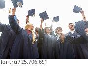 Купить «happy students or bachelors waving mortar boards», фото № 25706691, снято 24 сентября 2016 г. (c) Syda Productions / Фотобанк Лори