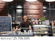 happy seller man or barman at cafe counter. Стоковое фото, фотограф Syda Productions / Фотобанк Лори