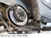 Купить «car brake disc at repair station», фото № 25706959, снято 1 июля 2016 г. (c) Syda Productions / Фотобанк Лори