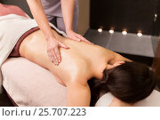 Купить «woman lying and having back massage at spa parlor», фото № 25707223, снято 26 января 2017 г. (c) Syda Productions / Фотобанк Лори