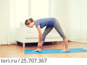 Купить «woman making yoga intense stretch pose on mat», фото № 25707367, снято 13 ноября 2015 г. (c) Syda Productions / Фотобанк Лори