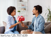 Купить «happy couple with bunch of flowers at home», фото № 25707639, снято 17 декабря 2016 г. (c) Syda Productions / Фотобанк Лори