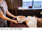 Купить «woman having face massage with towel at spa parlor», фото № 25707667, снято 26 января 2017 г. (c) Syda Productions / Фотобанк Лори