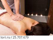 Купить «woman lying and having back massage at spa parlor», фото № 25707679, снято 26 января 2017 г. (c) Syda Productions / Фотобанк Лори