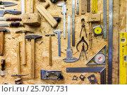 Купить «work tools hanging on wall at workshop», фото № 25707731, снято 8 апреля 2016 г. (c) Syda Productions / Фотобанк Лори