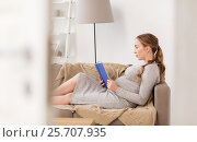 Купить «pregnant woman reading book at home», фото № 25707935, снято 24 ноября 2016 г. (c) Syda Productions / Фотобанк Лори