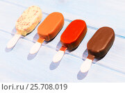Купить «Ice creams on table», фото № 25708019, снято 3 августа 2020 г. (c) Сергей Петерман / Фотобанк Лори