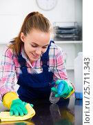 Купить «girl cleaning table with cloth», фото № 25711343, снято 23 мая 2018 г. (c) Яков Филимонов / Фотобанк Лори