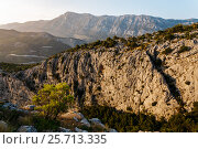 The slope of the cliff in the rays of the sun near Omis, Croatia. Стоковое фото, фотограф Андрей Орехов / Фотобанк Лори
