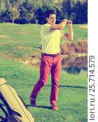 Купить «Male golf player made successful hit at golf course», фото № 25714579, снято 16 июля 2018 г. (c) Яков Филимонов / Фотобанк Лори