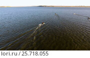 Купить «Aerial view of four motor boats floating on the longest river in Europe called Volga. 4K», видеоролик № 25718055, снято 2 марта 2017 г. (c) ActionStore / Фотобанк Лори