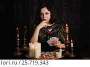 Купить «Young woman with divination cards in room», фото № 25719343, снято 5 марта 2017 г. (c) Майя Крученкова / Фотобанк Лори