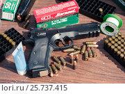 Купить «Пистолет и патроны», фото № 25737415, снято 20 февраля 2020 г. (c) Михаил Михин / Фотобанк Лори
