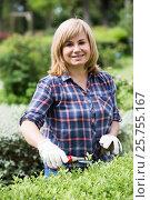 Купить «woman gardening instuments», фото № 25755167, снято 17 июня 2016 г. (c) Яков Филимонов / Фотобанк Лори