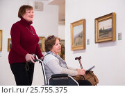 Купить «Two woman whatching art works», фото № 25755375, снято 16 сентября 2019 г. (c) Яков Филимонов / Фотобанк Лори