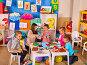Preschool scissors in kids hands cutting paper with techer in class., фото № 25755747, снято 4 октября 2015 г. (c) Gennadiy Poznyakov / Фотобанк Лори