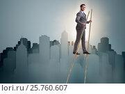 Купить «Businessman walking on stilts - standing out from the crowd», фото № 25760607, снято 23 февраля 2019 г. (c) Elnur / Фотобанк Лори