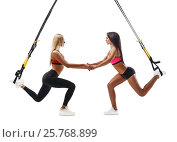 Купить «Fitness women doing lunge exercise with trx suspension», фото № 25768899, снято 28 января 2017 г. (c) Виталий Молев / Фотобанк Лори