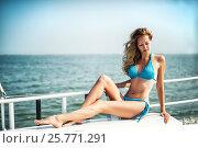 Купить «Beautiful girl sitting on the yacht board», фото № 25771291, снято 1 августа 2016 г. (c) katalinks / Фотобанк Лори
