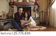 Купить «Beautiful couple in love near fireplace», видеоролик № 25775839, снято 25 января 2017 г. (c) Виктор Аллин / Фотобанк Лори