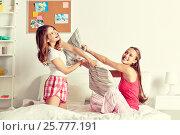 Купить «happy teen girl friends fighting pillows at home», фото № 25777191, снято 14 ноября 2015 г. (c) Syda Productions / Фотобанк Лори