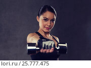 Купить «young woman flexing muscles with dumbbells in gym», фото № 25777475, снято 12 декабря 2015 г. (c) Syda Productions / Фотобанк Лори
