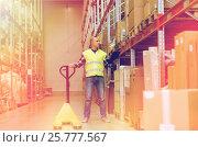 Купить «man with loader and clipboard at warehouse», фото № 25777567, снято 9 декабря 2015 г. (c) Syda Productions / Фотобанк Лори