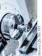 Купить «Metal workpiece clamped in the lathe chuck CNC machine», фото № 25781191, снято 25 мая 2016 г. (c) Андрей Радченко / Фотобанк Лори