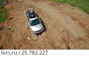 IZHEVSK, RUSSIA - JUNE 22, 2014: Aerial view Kia Mohave at offroad test drive. Редакционное видео, видеограф Илья Насакин / Фотобанк Лори