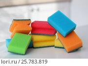 Купить «Разноцветные губки на кухонном столе», фото № 25783819, снято 13 февраля 2017 г. (c) ok_fotoday / Фотобанк Лори