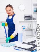 Купить «Young female cleaner polishing surfaces at office», фото № 25786007, снято 21 июля 2018 г. (c) Яков Филимонов / Фотобанк Лори