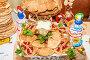 Блины со сгущённым молоком, украшенные гранатовыми зернами и душистой мятой, фото № 25791075, снято 24 декабря 2015 г. (c) Алёшина Оксана / Фотобанк Лори