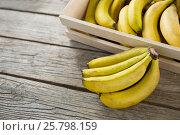 Купить «Bananas in wooden crate», фото № 25798159, снято 19 декабря 2016 г. (c) Wavebreak Media / Фотобанк Лори