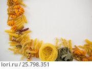 Купить «Varieties of pasta arranged on white background», фото № 25798351, снято 13 октября 2016 г. (c) Wavebreak Media / Фотобанк Лори