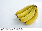 Купить «Close-up of fresh bunch of bananas», фото № 25798735, снято 19 декабря 2016 г. (c) Wavebreak Media / Фотобанк Лори